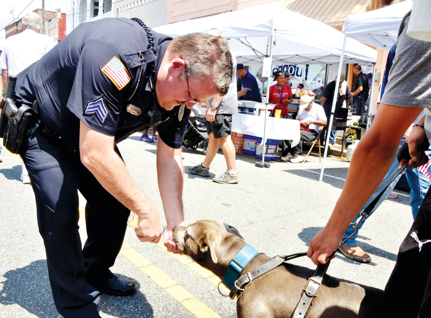 Siler City Police Department Sergeant Jon Murray gives 'Choppie' a drink Saturday afternoon at the Spring Chicken Festival.