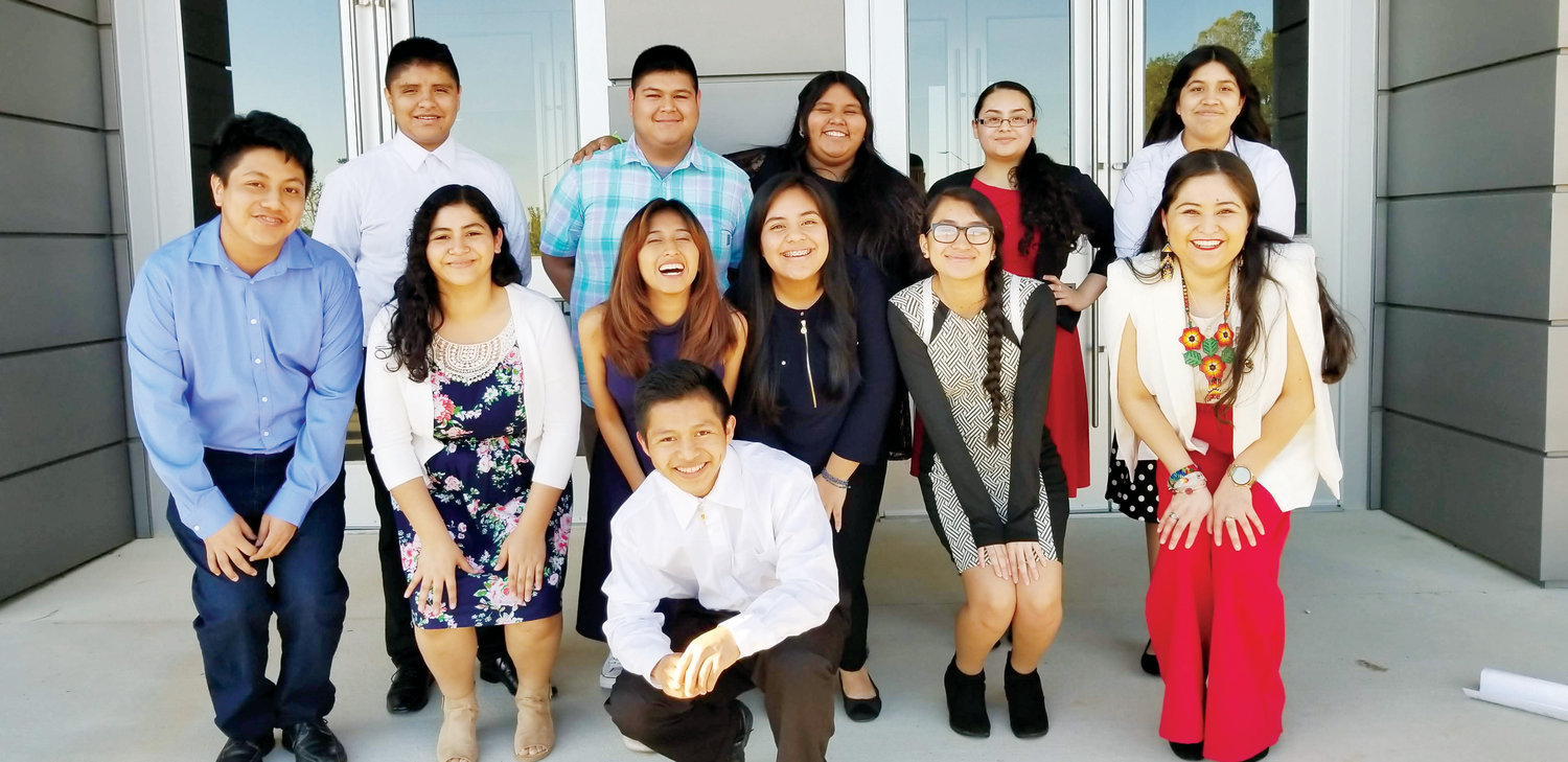 Group photo of the 11 youth who presented at the County Commissioners meeting. From left to right, back row: Ervin, Oscar, Cesia, Noemi, & Berenice. From left to right, front row: Carlos, Jocelyn, Jackie, Lenore, Liz, Selina Lopez. At the very front is Esmar. Not picture: Grecia.