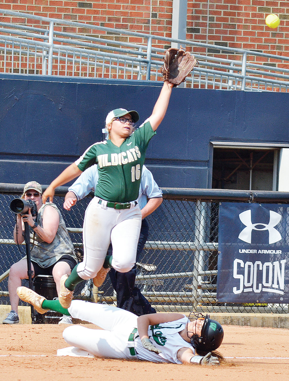 Eastern Randolph's Gerrilyn Milligan reaches for a wild throw as West Stanly's Morgan Edwards slides for third in the first inning of their last state Championship game at UNCG Sunday afternoon. Randolph lost the game and the Championship, 3-0.