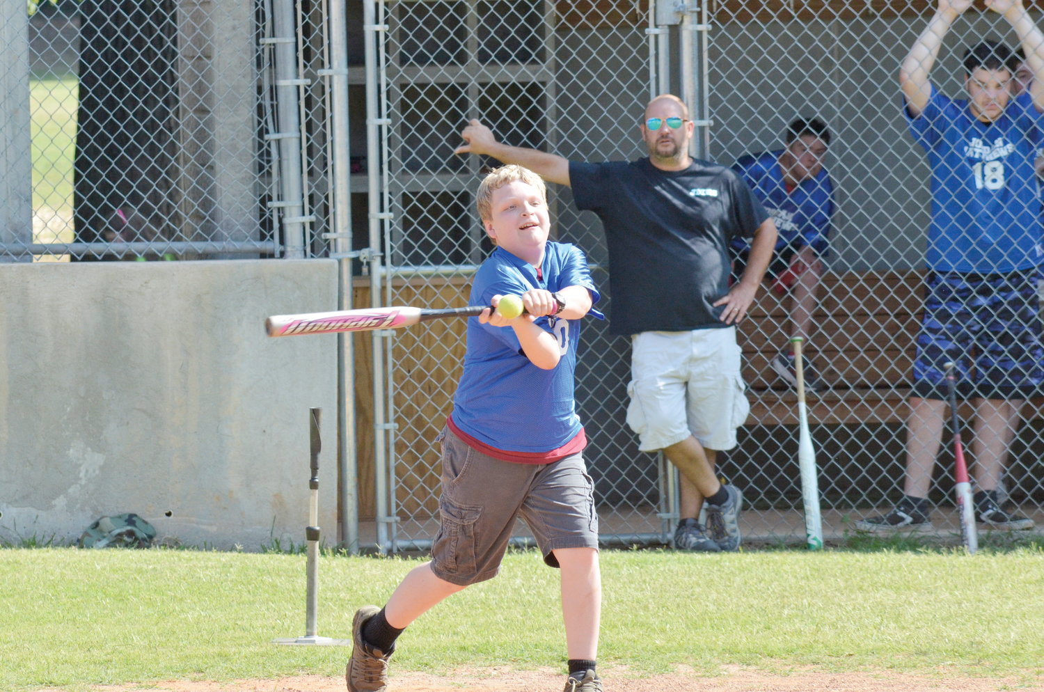 Jordan-Matthew's Nathan Allred gets a hit during the UNIFIED game against Northwood Friday. JM won the highly contested match, 21-20.