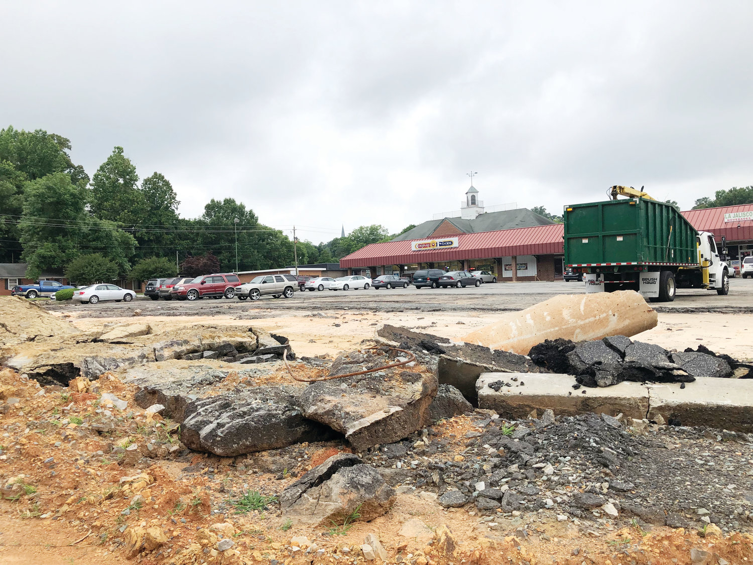 Siler City officials say the deteriorating condition of the Park Shopping Center parking lot violates town ordinances and the property owner could face fines soon if repairs aren't completed.