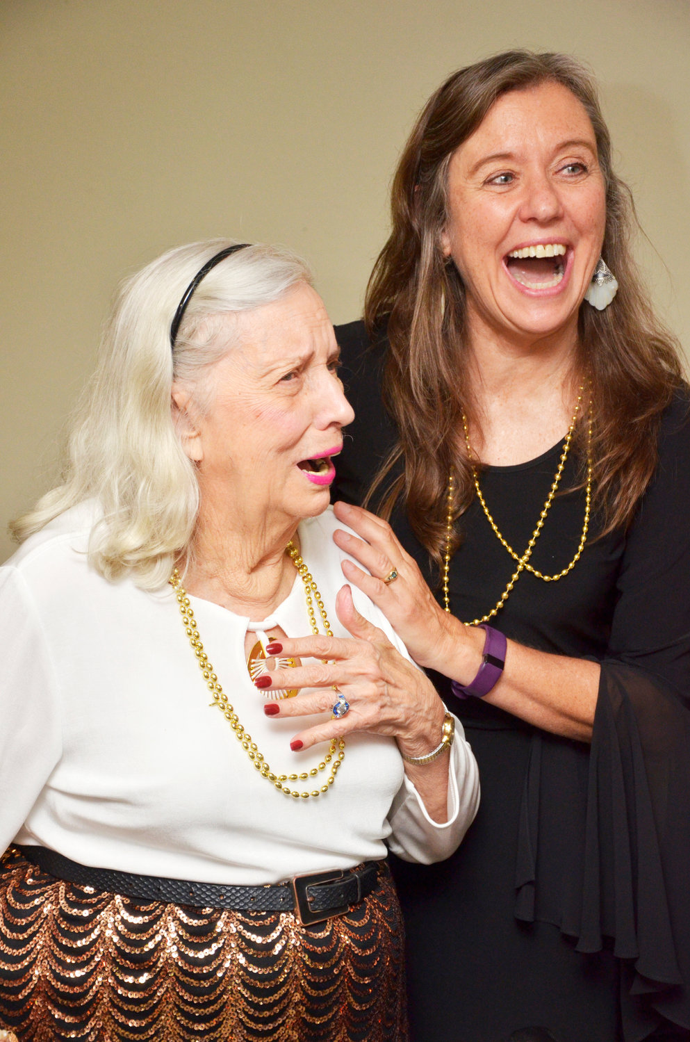 Kit Fink, left, learns she is the winner of the 2019 Ms. Cambridge Hills Pageant. Her daughter, Becky Fricke, sharesthe moment with her.