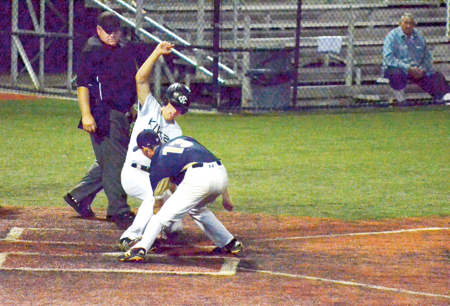 Post 81's Nate Canter comes in to defend home base in recent American Legion action.