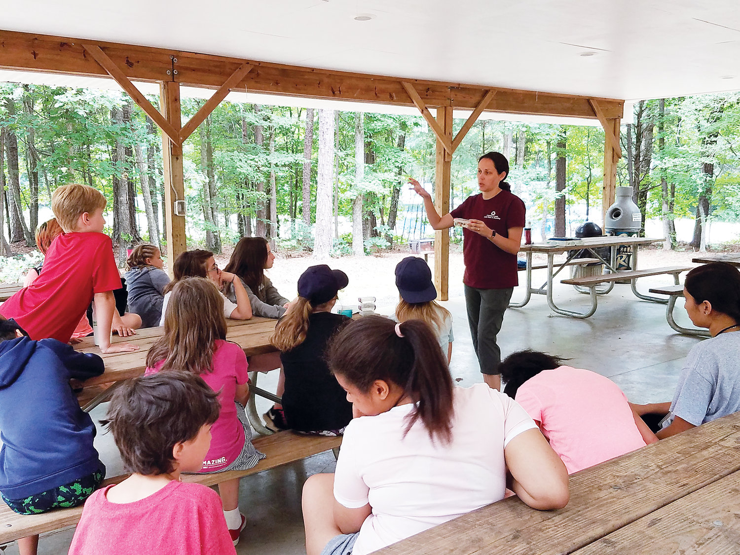 Here Shannon Culpepper, Waste Reduction Coordinator for Chatham County Solid Waste & Recycling, is .teaching a recycling lesson at 4-H camp.