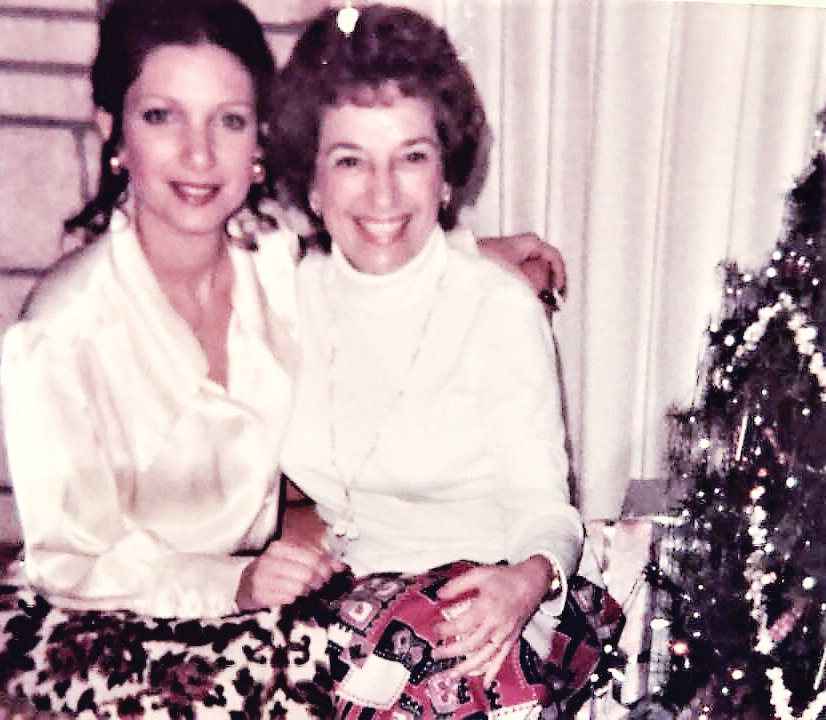 Jessica, left, and her mother Pauline sit beside the Christmas tree in 1973.
