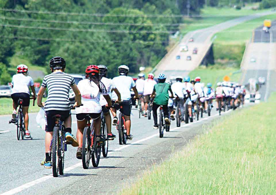 The kids rode down highway 64 to get to Jordan Lake after spending the week training for the journey.