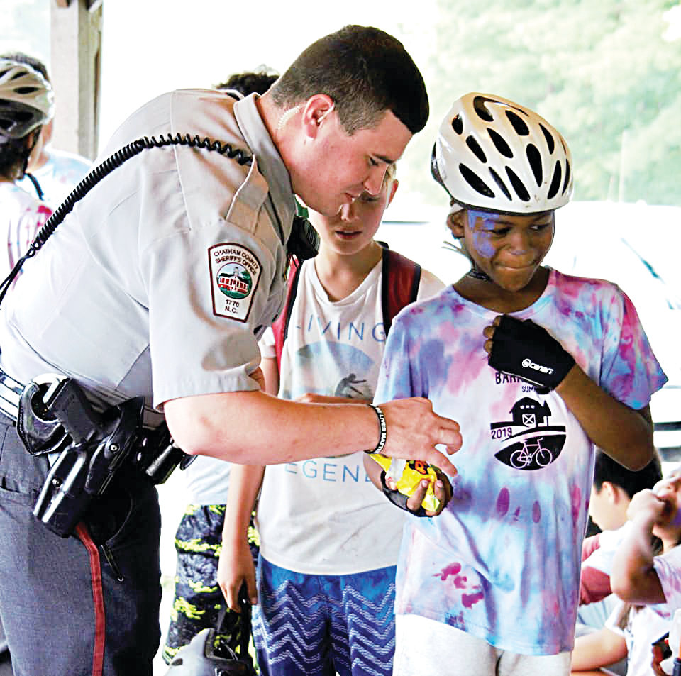 The kids were given some quality one-on-one time with the kids at they waited out the storm. Here one camper shares gummi worms with a deputy.