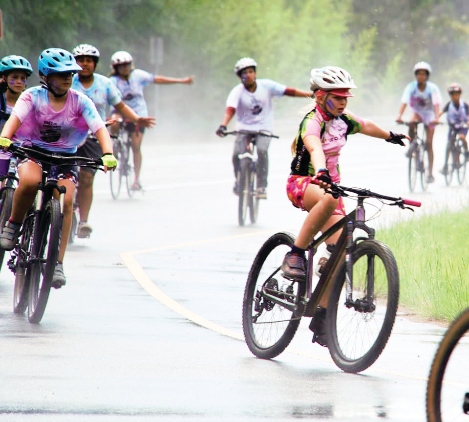 About 30 children braved the severe storms last week to make the 17-mile trek from Pittsboro to Jordan Lake by bicycle.