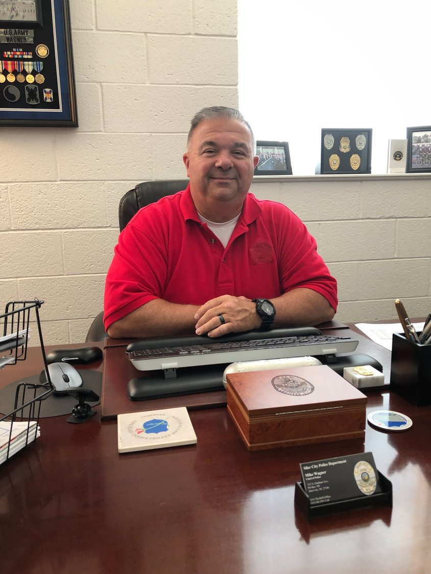 Mike Wagner, Siler City's new police chief, has been on the job since June 3. He's been busy getting to know his new community, introducing himself to merchants throughout town, and meeting individually with his staff of 21 sworn officers.