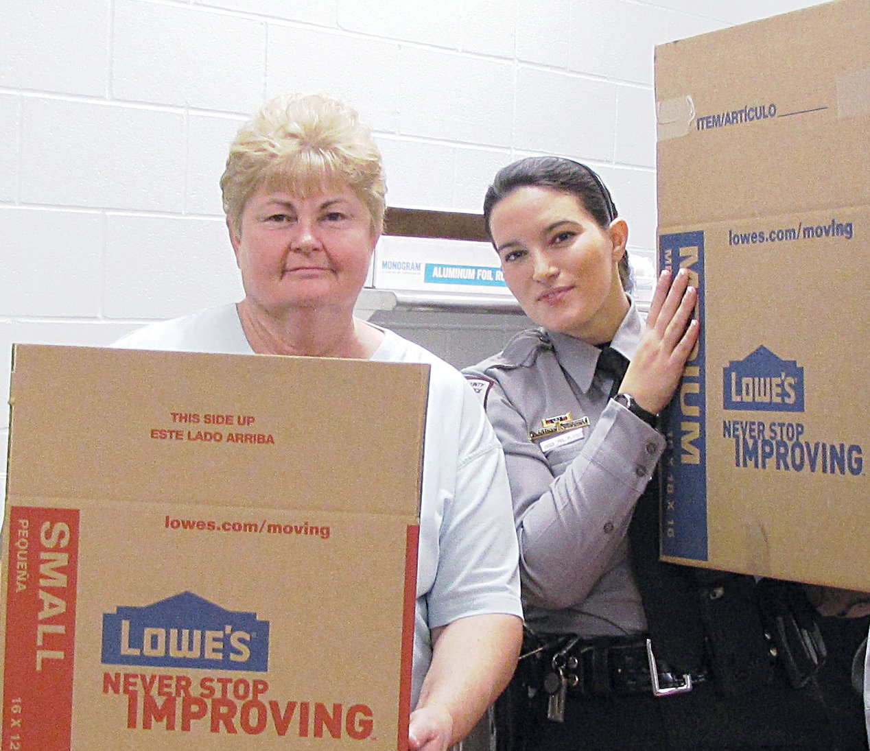 Sara Pack (right) and her mother, Ann Ritter, deliver meals during one of the Chatham County Sheriff's Office's annual Thanksgiving programs.