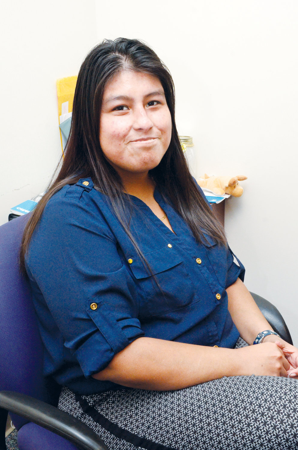 Leslie Ocampo coordinates the outreach program at the center, but also oversees the 'laptop-reward' program that rewards students with a free  laptop after achieving a planned long-term goal.