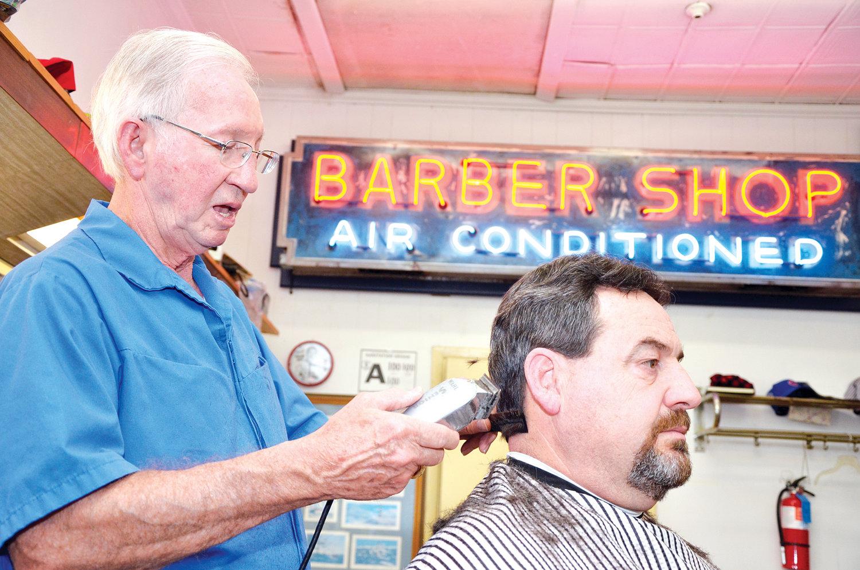 Cadle Cooper clips along, spans half century of main street change