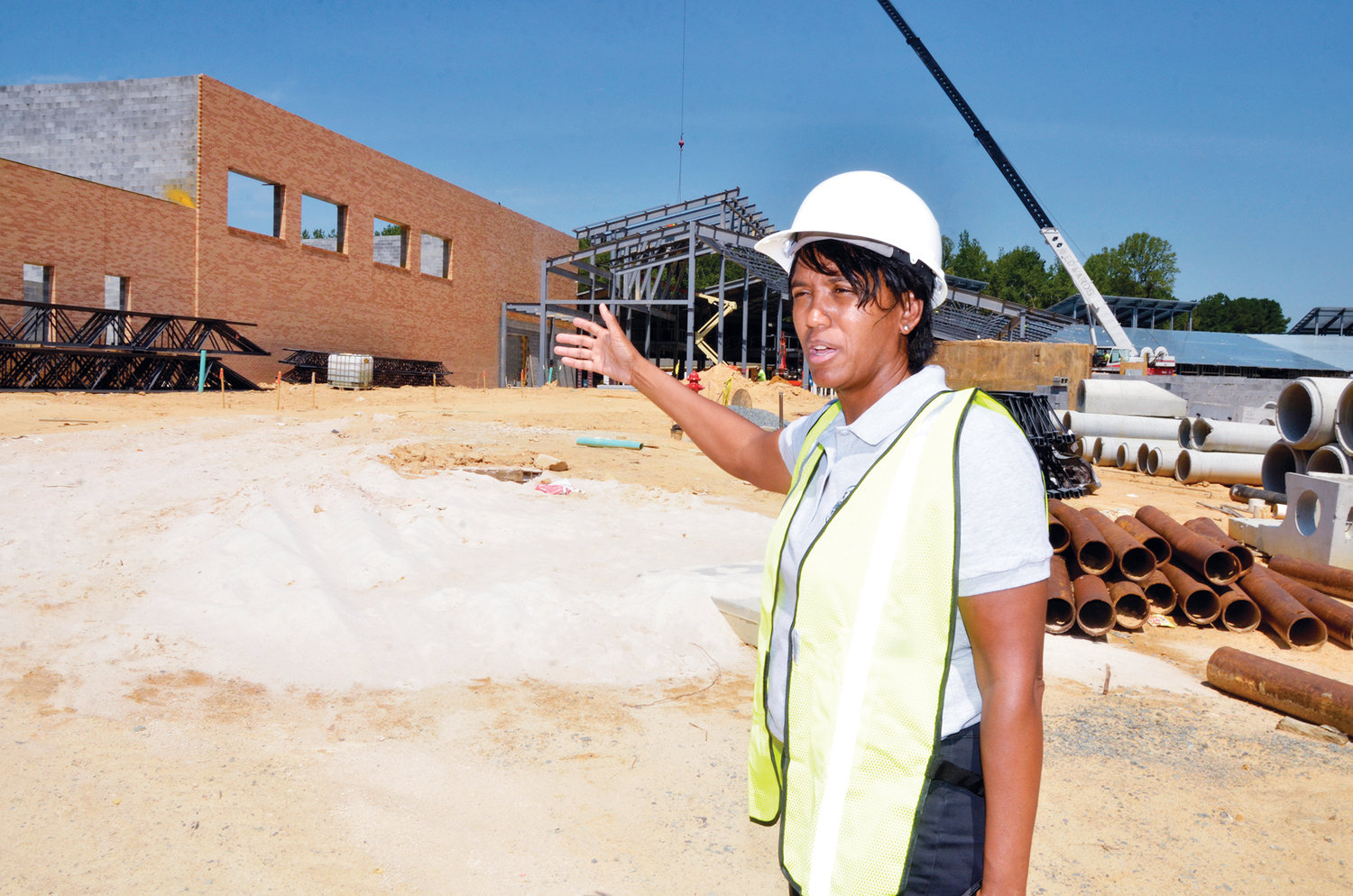 Chatham County Parks and Recreation Department Director Tracy Burnett was born and raised in Chatham County. Burnett stands in the gym of the new elementary school being built in Chapel Hill across from Margaret Pollard Middle School.