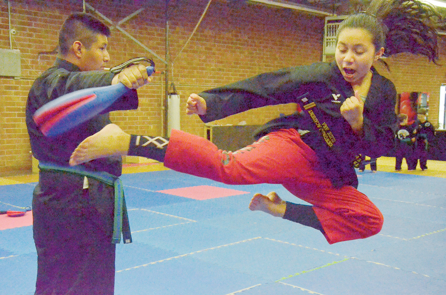 Eli Ara, 12, performs a flying kick at the AFE TKD Martial Arts The Best of Siler City Academy on Monday. Ara has been taking lessons since she was 3 years old.