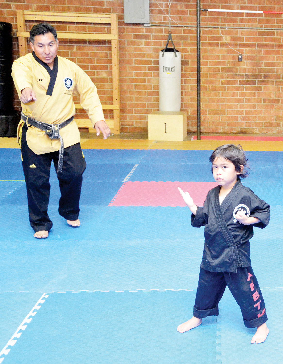 Master Antonio Ara instructs Violeta Trujillo at AFE TKD Martial Arts The Best of Siler City Academy on 11th Street on Monday. Trujillo was attending one of the many classes available at the school.