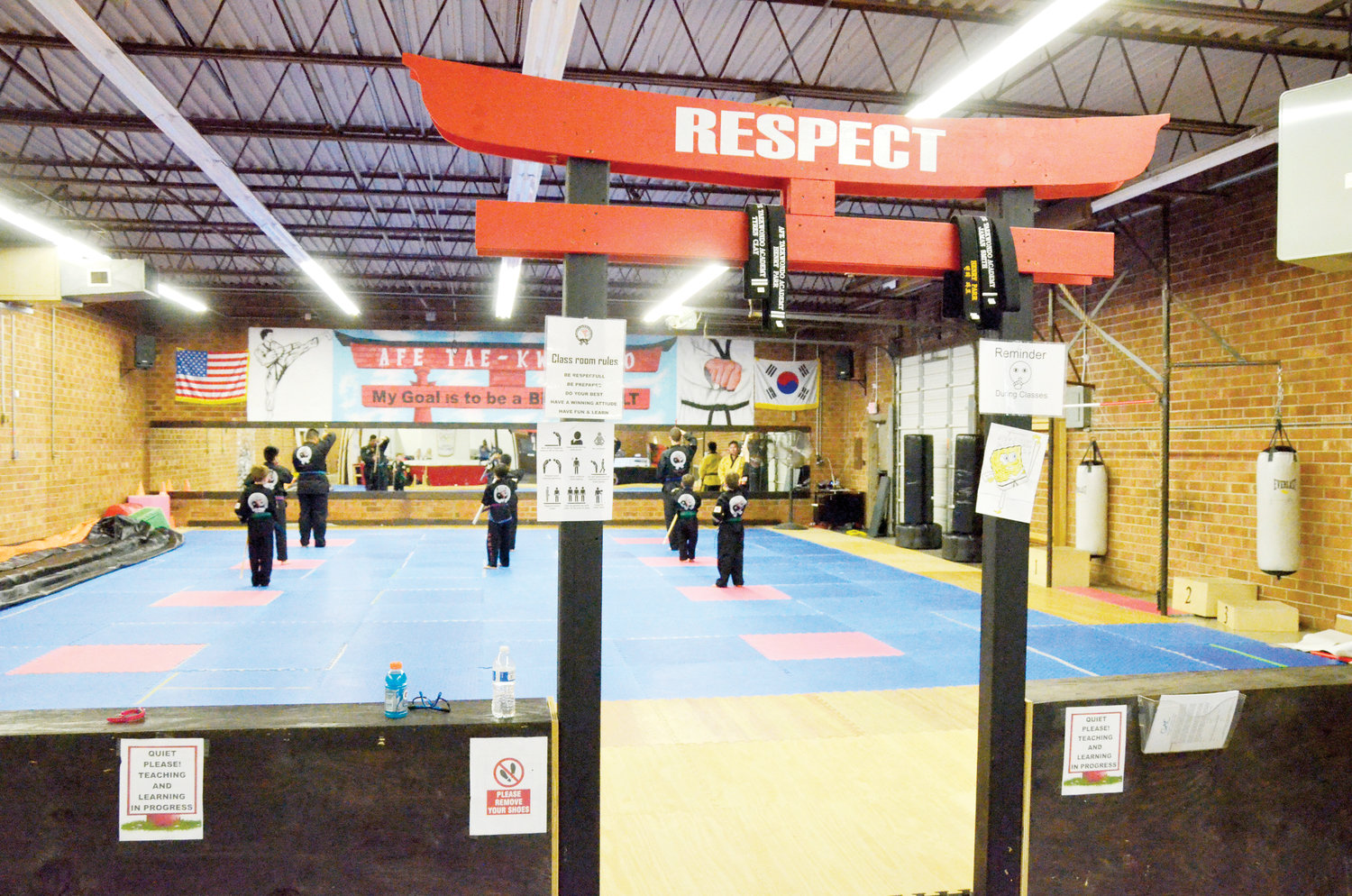 Master Antonio teaches his class the fundamentals and advanced blocks, strikes and punches in the Taekwondo system at his AFE studio in Siler City.