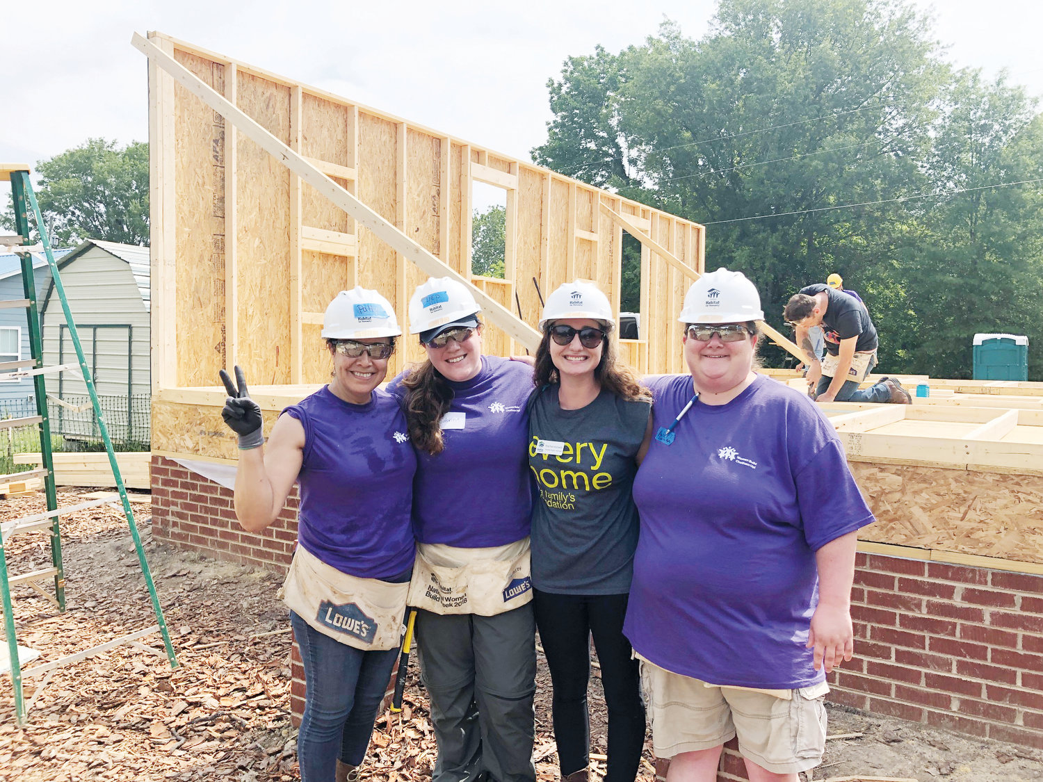 From left, Chatham Habitat for Humanity employees Patricia Morales (Family Services Director), Sabrina Bonomolo (ReStore Associate), Rachel Horowitz and Amber Thompson (ReStore Too Manager) pose at a work site.