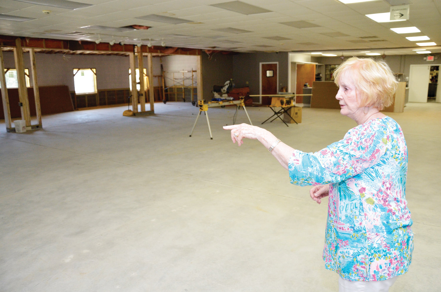 Berta Lou Scott, co-owner of Southern Supreme Fruitcake, surveys the business new showroom area under construction. The space will provide more room for customers to browse for the right gift items for friends and family.