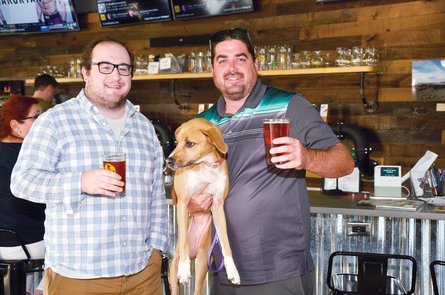 Nate Bauer and James Dail, holding Lucy, enjoy the atmosphere at House of Hops. 'We were looking for a dog-friendly bar,' Dail said. 'After a long week, it's good to unwind here.'