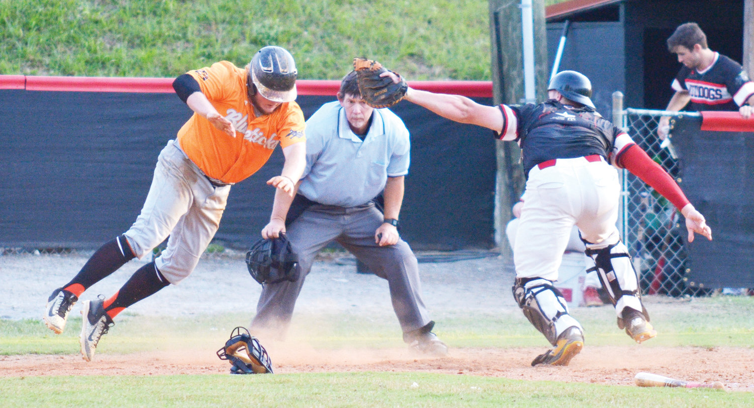Guilford Bluetick's Joshua Bonfield gets past Deep River Muddog's Jordan Cassell in Wednesday night's playoff game at Craven Stadium in Ramseur. With the loss of the game, 4-2, the season ended for the Muddogs.