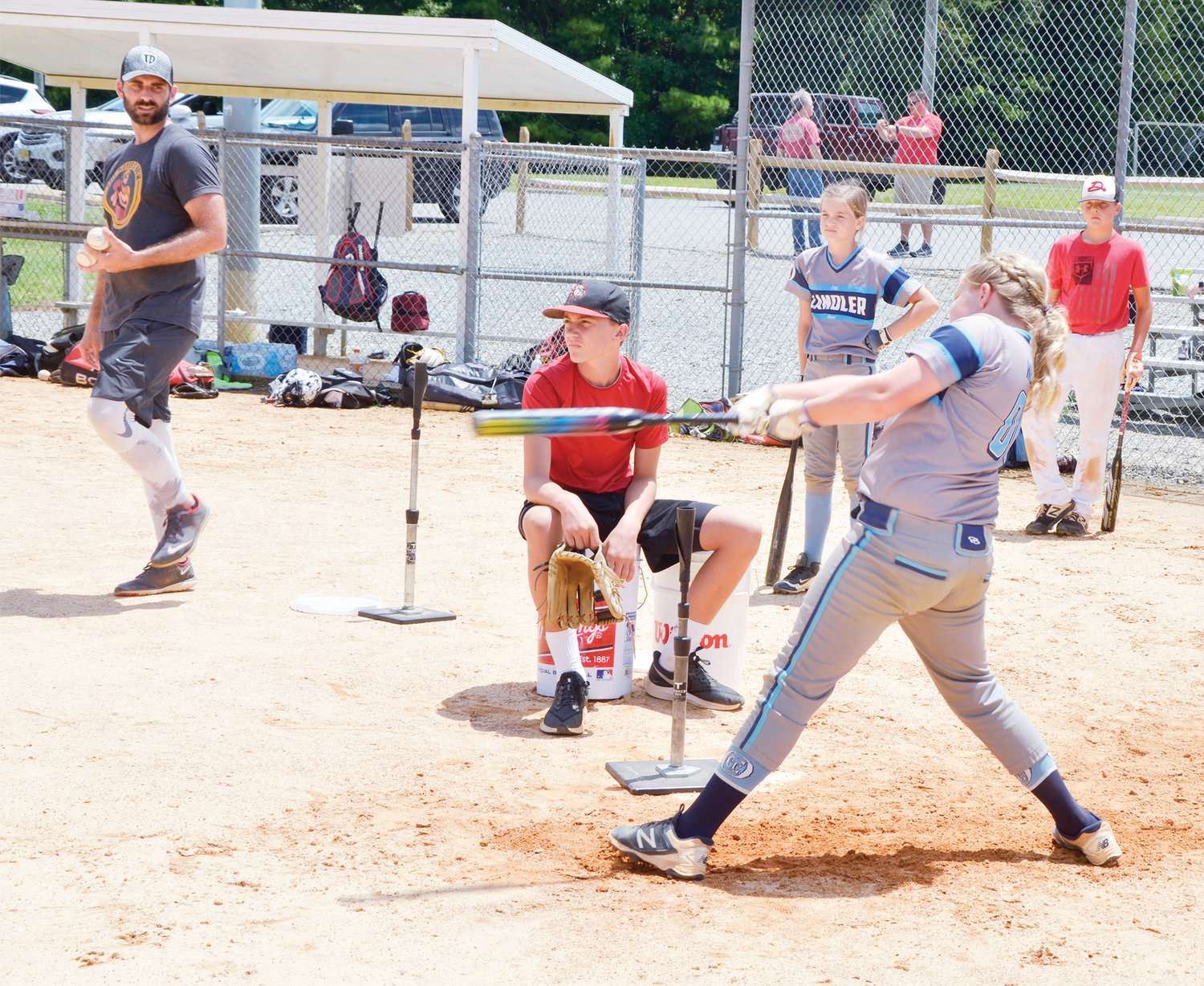 Layla Worley, 11, takes a powerful swing in the baseball clinic at Bray Park. She was one of the two softball players who took advantage of the teaching experience.