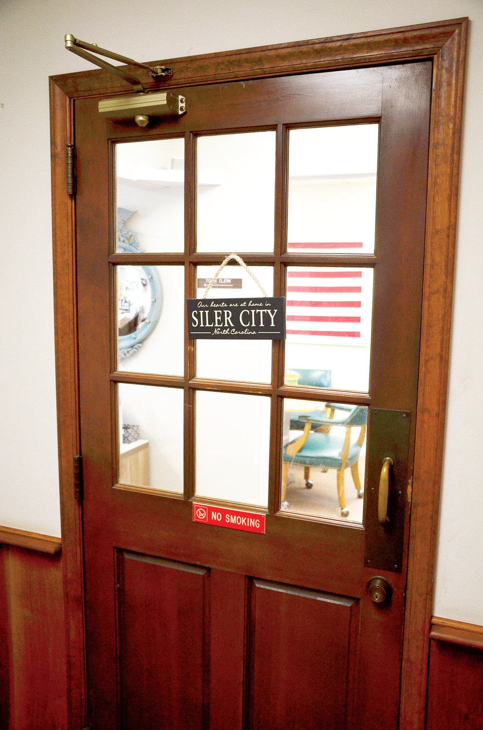 The Town of Siler City currently prohibits smoking inside town-owned property, as shown on this door to town offices.