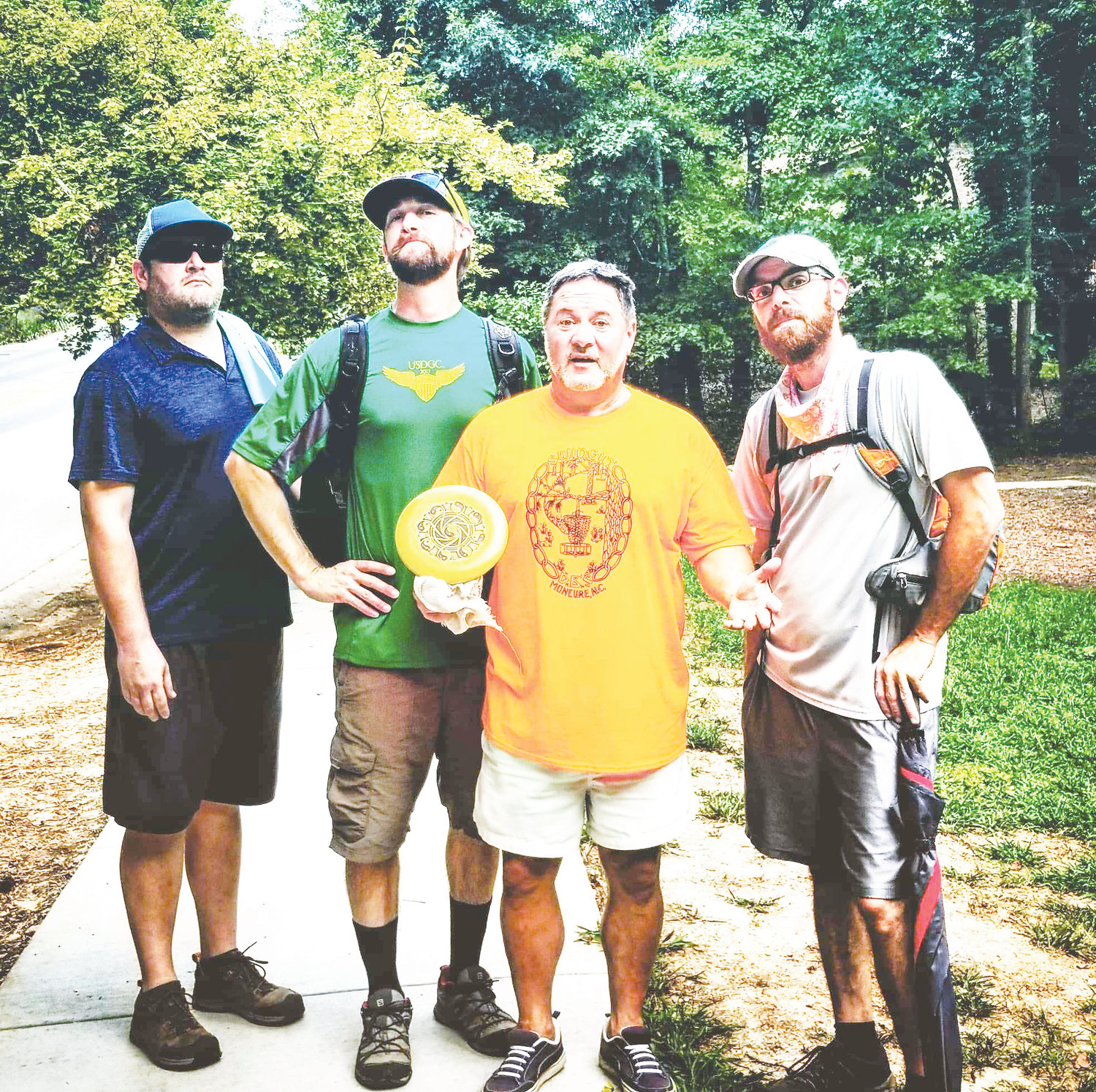 The 'King of Kentwood' (center with disc) is one of the winningest disc golfers in North Carolina, though many were won outside of the Professional Disc Golf Association. Here he's joined by T-Baby, Sethro and Jefferson as they finish up another amazing round.