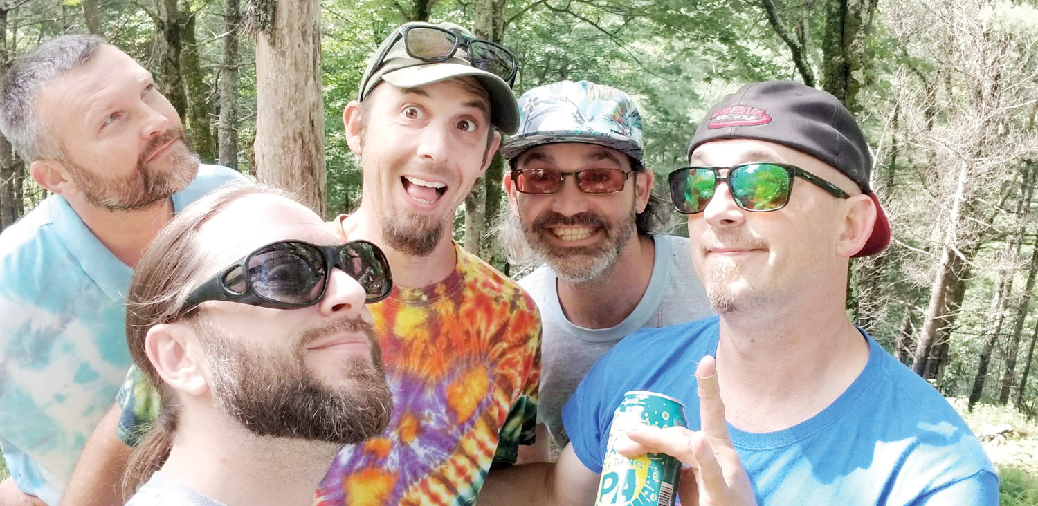 Disc golf is as much about the fun and community as it is the game. Here Tunny, Detroit Drew, JB, Skizzy, and Rich $ enjoy a fun moment in between holes.