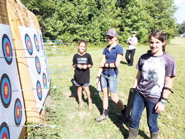Members of the newly formed Chatham County 4-H Club's Shooting and Hunter Skills team check how successful they were on the targets in archery.