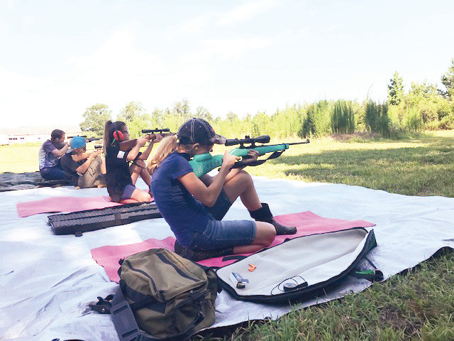 Taking careful aim at the target, Chatham County 4-H Shooting and Hunter Skills team members prepare for the upcoming district championships on August 17 in Ellerbe.