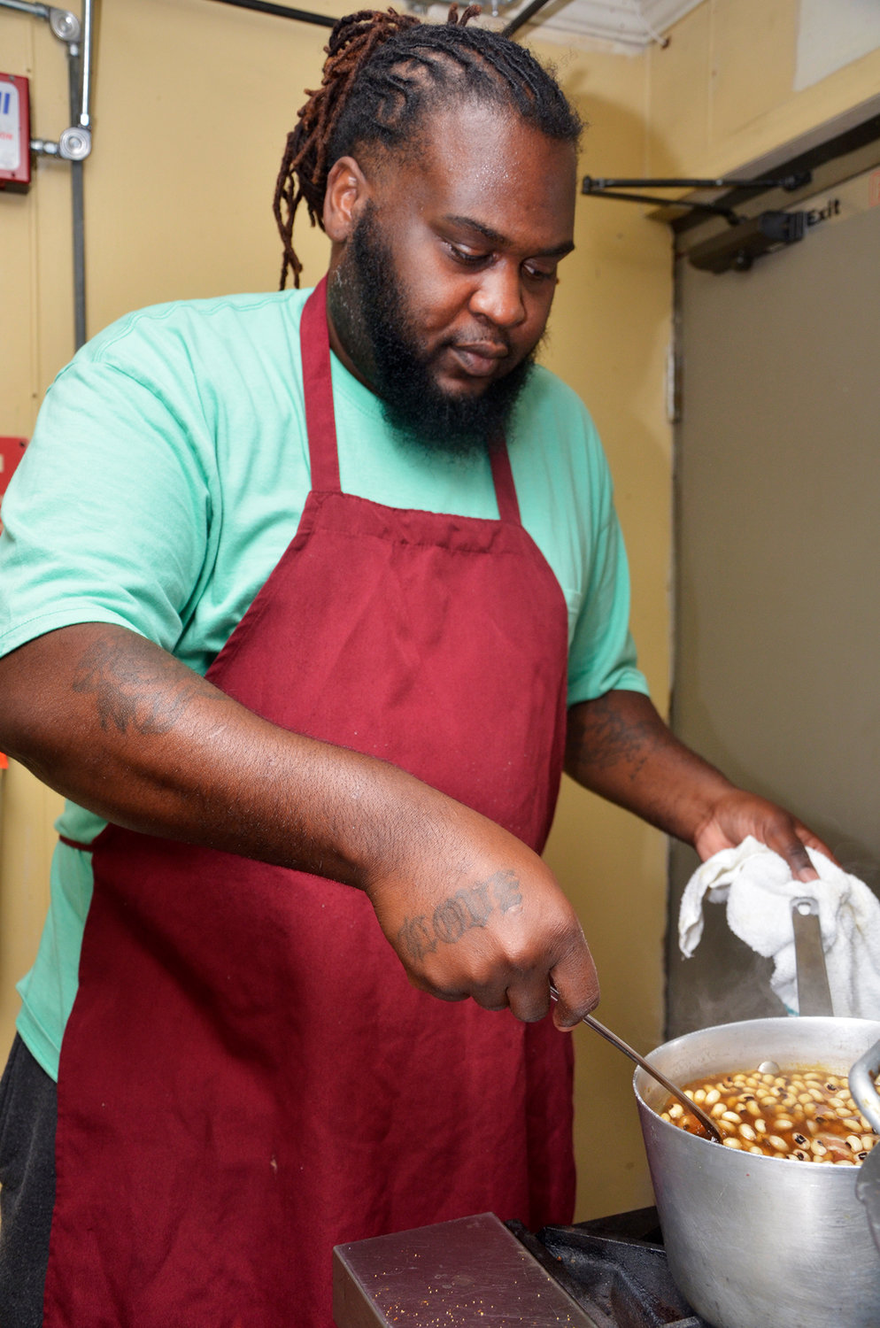 The 'Soul Roll' is a specialty of the house. Last Thursday, Andre Chaney, owner of the new A & I Chicken Shack, stirs the black-eyed peas that will be added to collards and potatoes to make the tasty dish. Every recipe is a family recipe.
