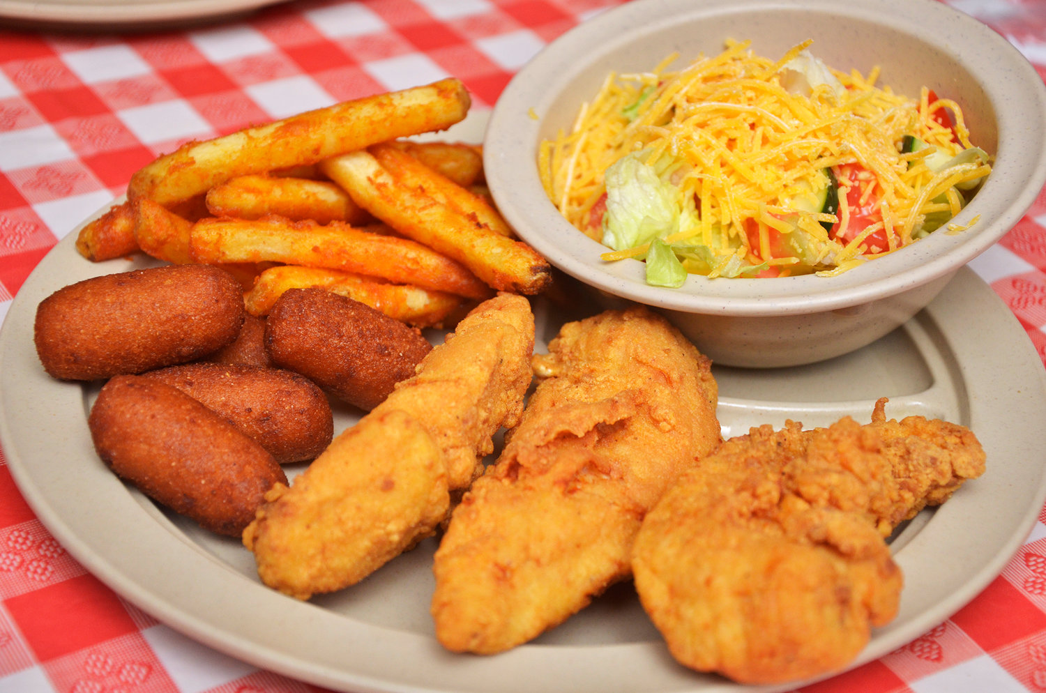 This is one of the standard menu items that's available everyday. Diners have choices of several chicken or pork dishes, with classic southern sides to complete the meal.