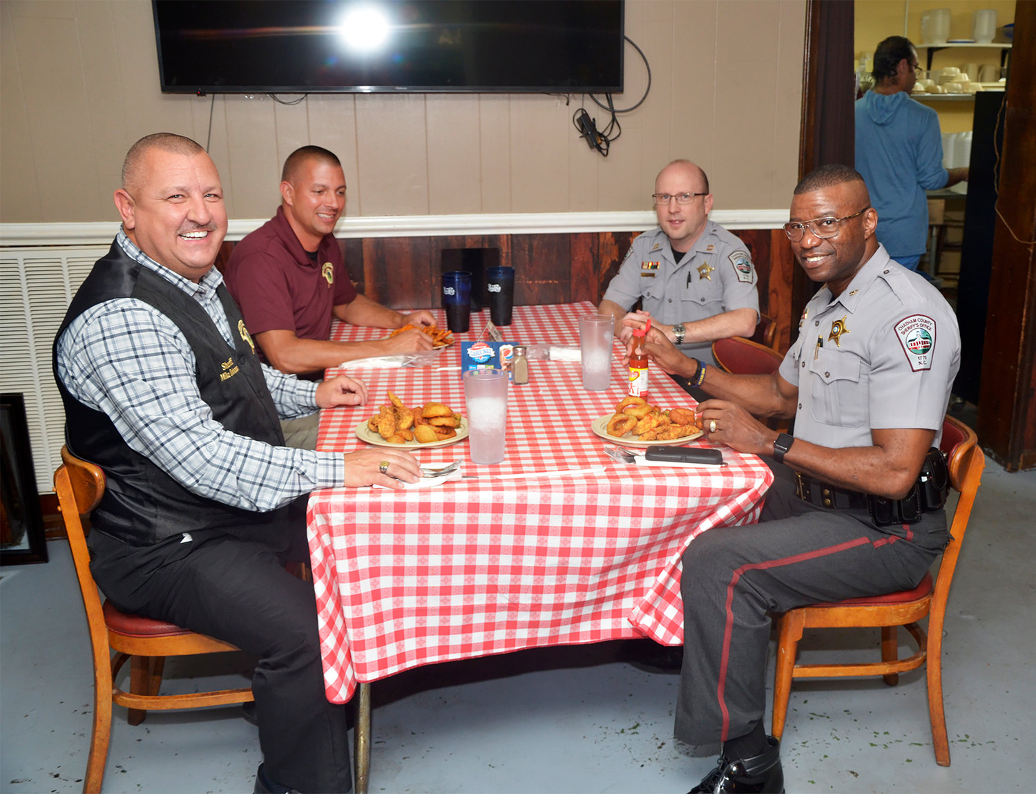 Chatham County Sheriff Mike Roberson, Captain Steve Maynor, Captain Chris Cooper and Deputy Chief Charles Gardner enjoy a meal at the Chicken Shack. Roberson is making his feelings clear.