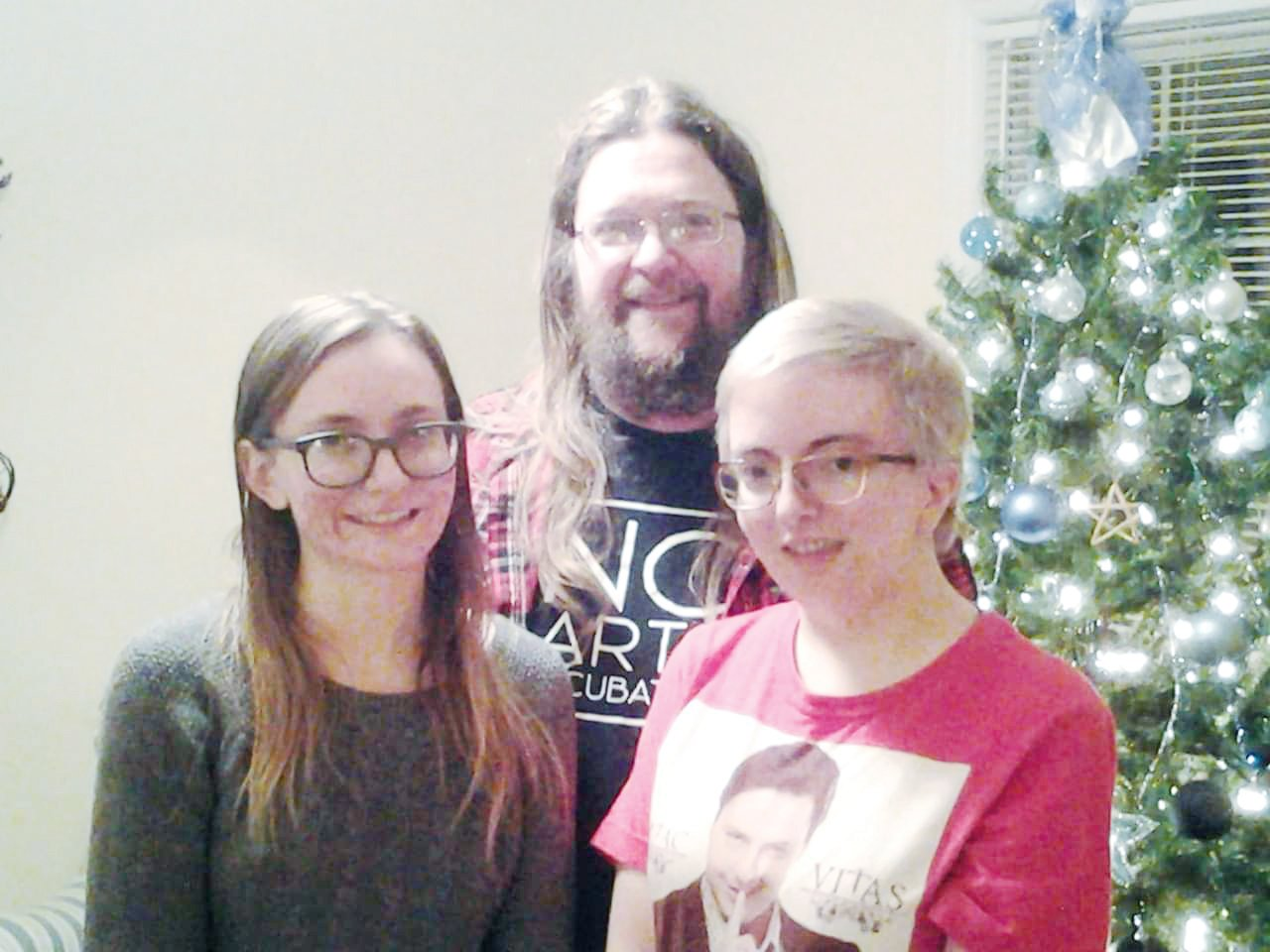 JR Butler (center) with his daughters Makayla Butler (left) and Danielle Riley (right) this past Christmas.