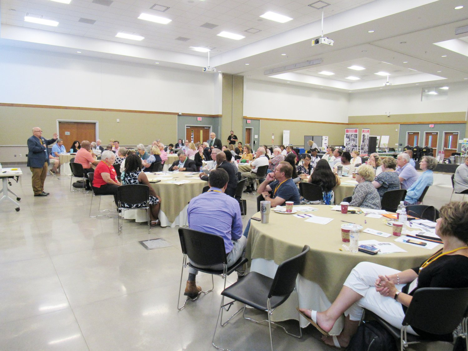 Rich Gwaltney (left, dark blue jacket) leads the discussion August 12 at the Chatham Council on Aging's Clergy Summit at the Chatham County Agricultural and Conference Center in Pittsboro.
