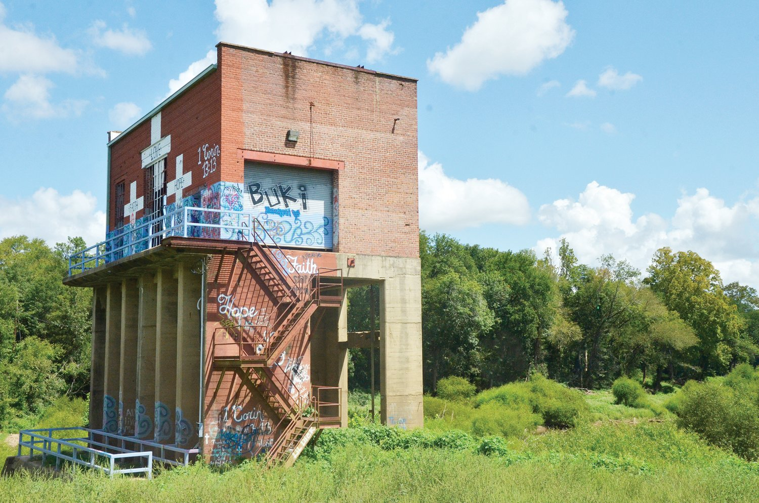 The old power generator building for the Carbonton Dam sits on an outcropping beside the river. Once the main power source for Carbonton, it was abandoned after a new structure was built to power Moncure and surrounding communities.The building left behind is now an artists' canvas.
