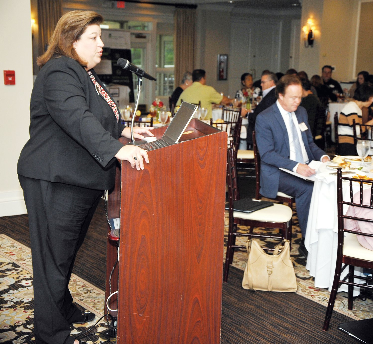 Heather Black tells the audience at last Thursday's United Way of Chatham County campaign kickoff about how the NCCARE360 program will be working in the Chatham County community.