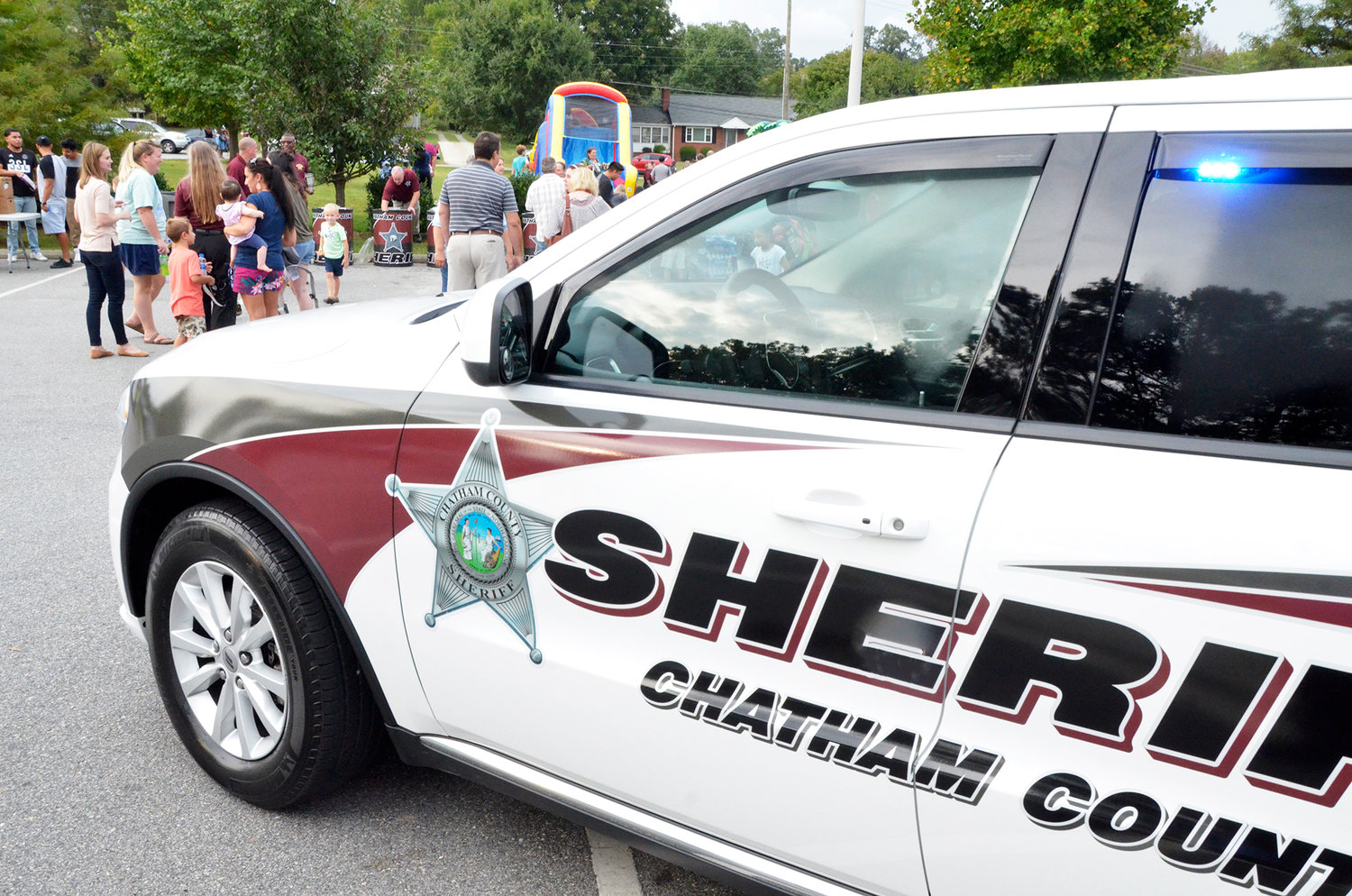 A Community Appreciation event was held last Friday at the Chatham County Sheriff's Office on West Street in Pittsboro. The event was held to introduce members of the community to the officers and deputies who watch over them. There was food and drink, a bouncy castle, and fun for the whole family.