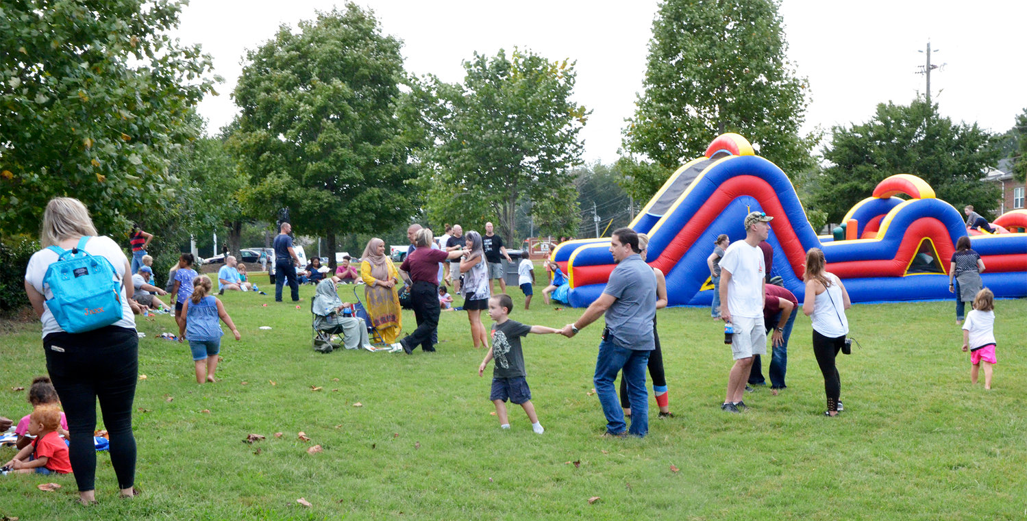 The large grassy field in front of the Chatham County Sheriff's Office made a perfect place for the kids to play. Families came with their children to enjoy the slides and bouncy castles, listen to music, and play.