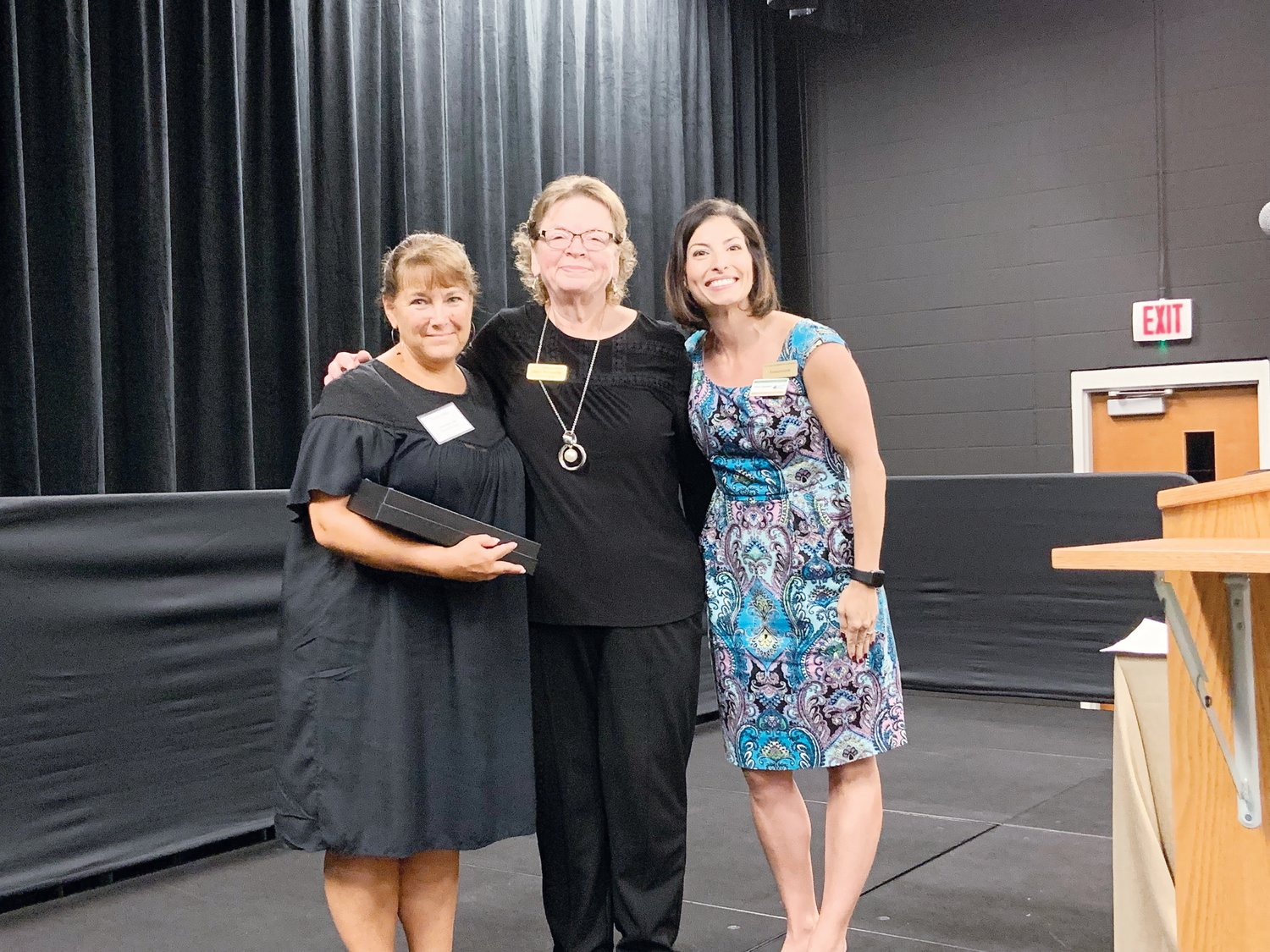 Ronda Stubbs, left, marketing director for Cambridge Hills Assisted Living, receives the award for Chamber Ambassador of the Year, presented by Cindy Poindexter of the Chatham Chamber, middle, and Erica Sanders, at the Chatham Chamber of Commerce's Annual Meeting last week in Pittsboro.