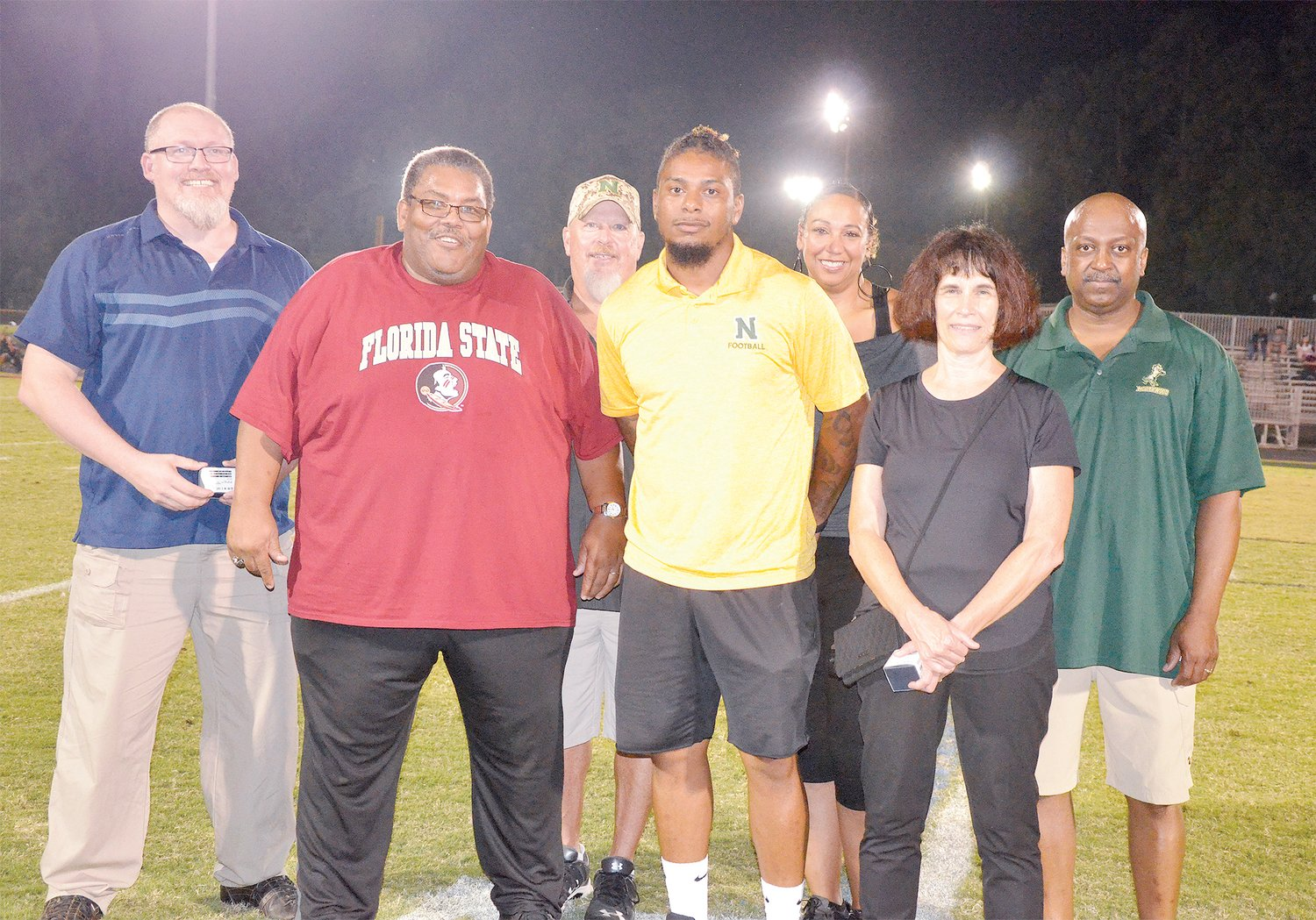 New inductees into the Northwood High Hall of Fame made their appearance in last Friday's game in Pittsboro. They are, from left, Will Shambley, Ronald Brooks, Bill Hall, Tobias Palmmer, Latanya Davis, Kathryn Dispennette and Craig Adams.