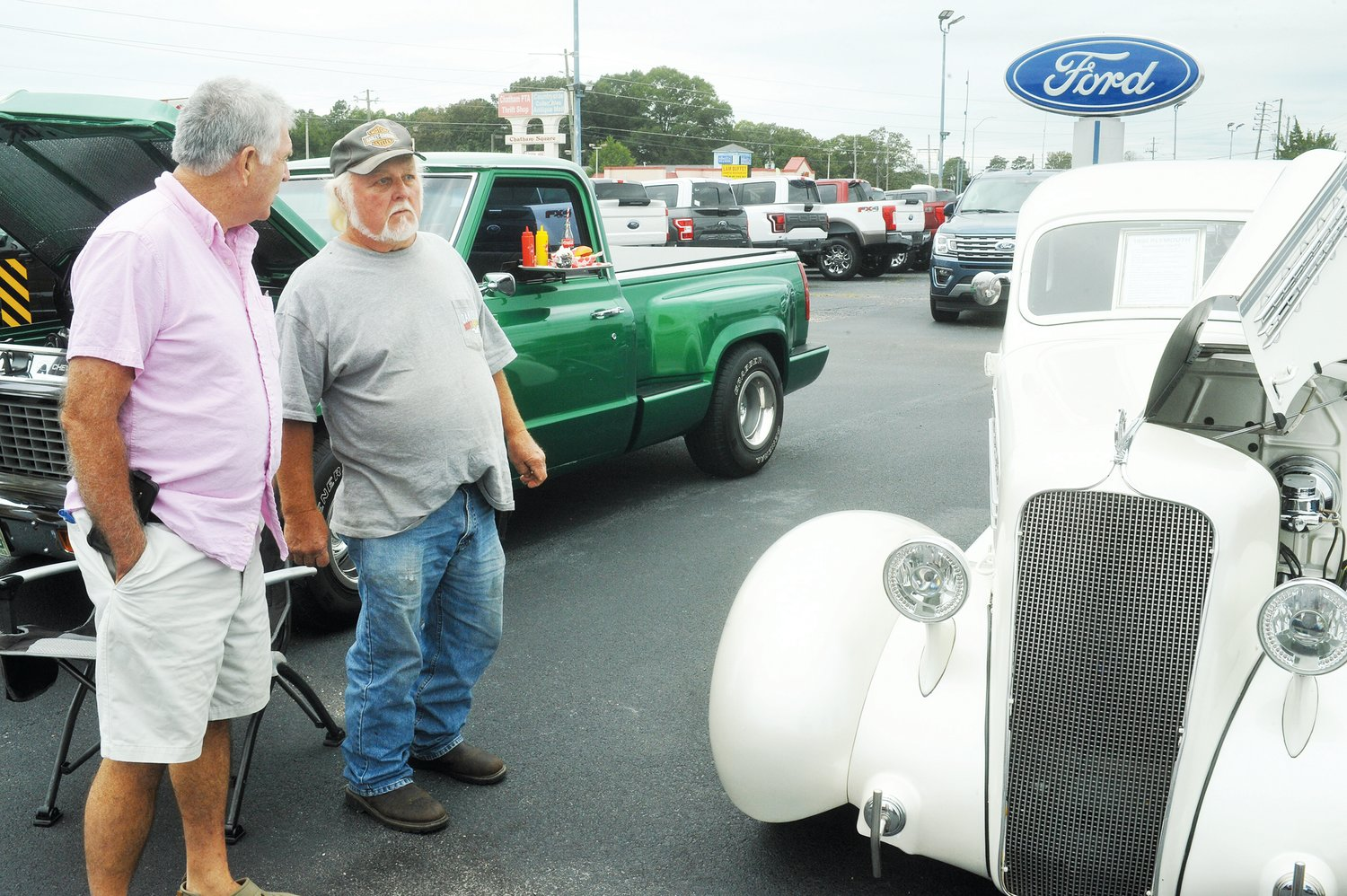 Spud Wilson and Herman Hart look over a '35 Plymouth Business Coupe in the Classic Car Cruise-In show at Harris Ford in Siler City Saturday. The car show show was held in conjunction with the Chatham Chili Challenge which  benefitted the Boys and Girls Club.