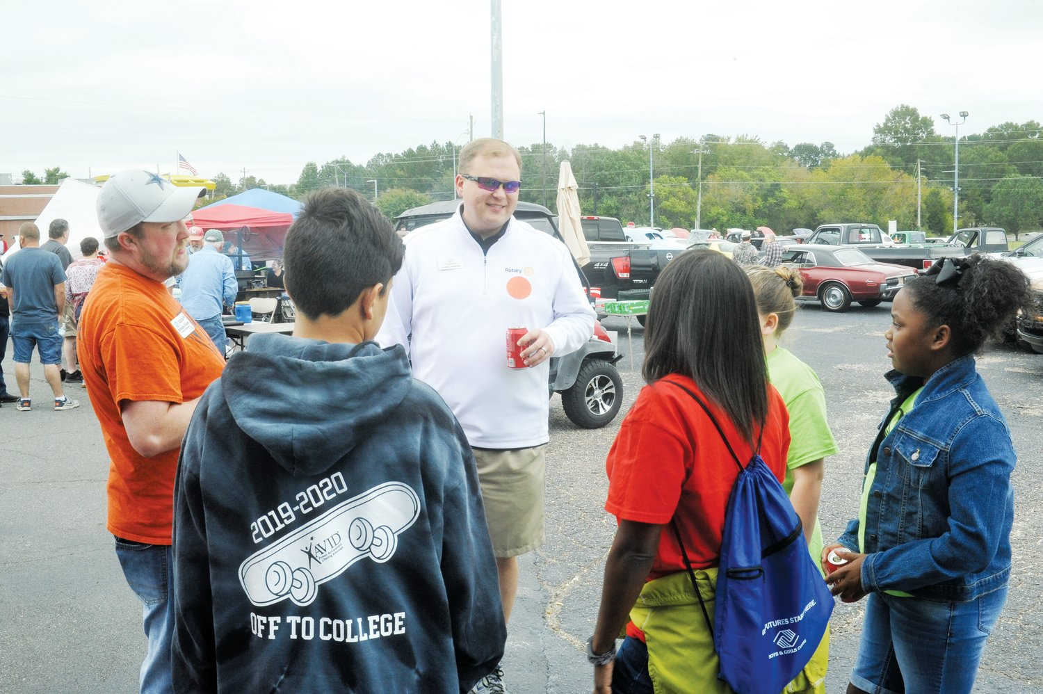 Brandon Kivett and Daniel Simmons, with Boys and Girls Club, chat with some of the local children who will benefit from the funds raised at Saturday's Chatham Chili Challenge. Traci Newby, (not pictured) the education room program leader, said it is one of the biggest fund raising events of the year, with all proceeds going to the club.