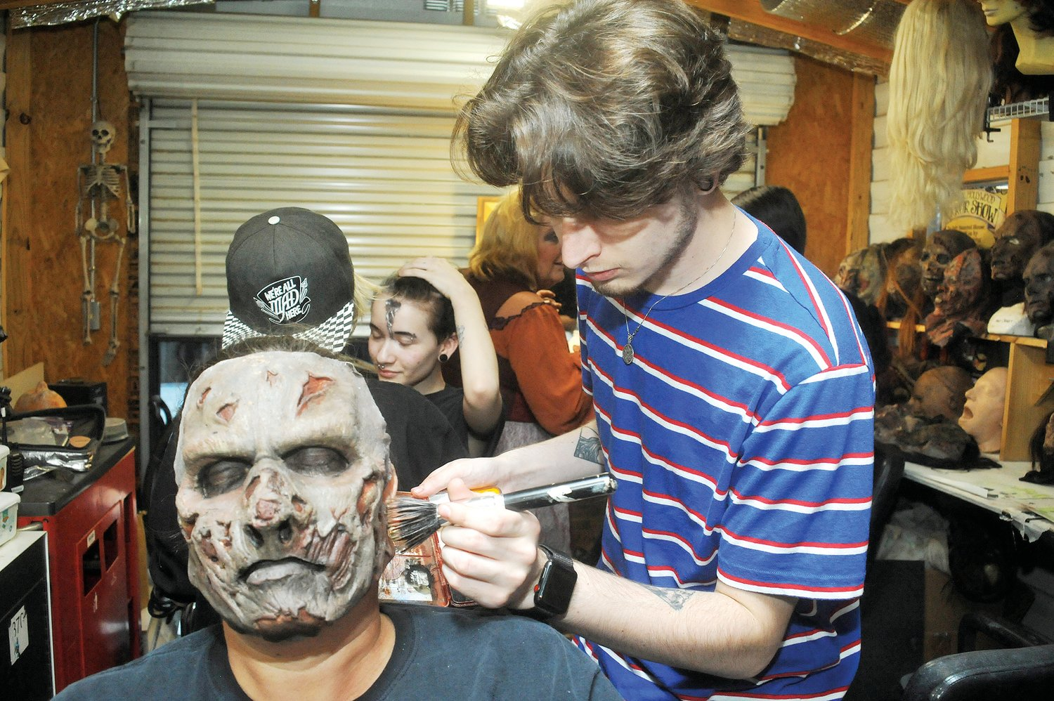 Amy Mabe gets a few final touches with a brush as she is transformed into a zombie by makeup artist Tyler Wood in preparation last Friday for the Original Hollywood Horror Show.