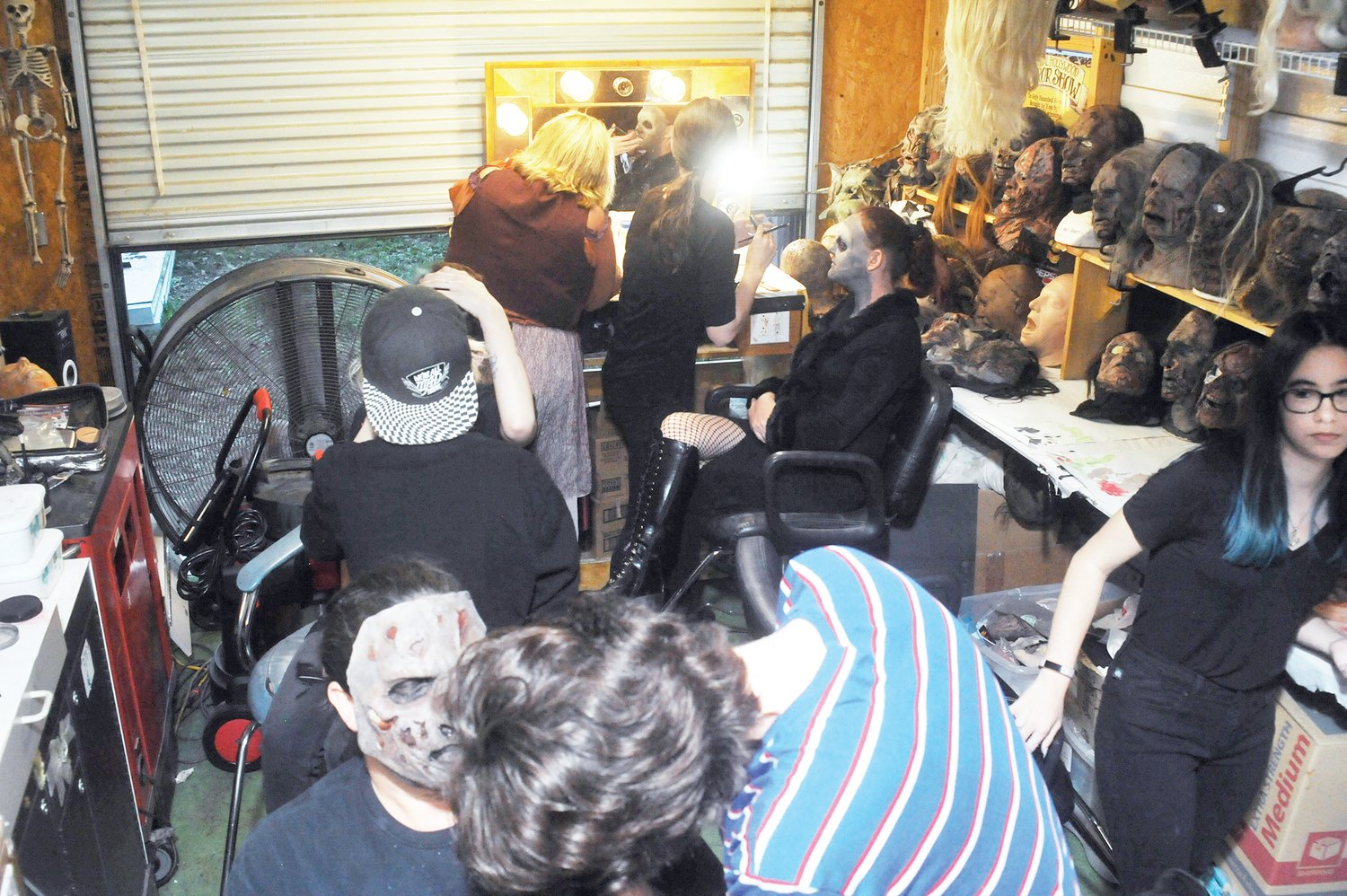 A rogue's gallery of rubber masks line the walls of a makeup trailer in Snow Camp, the room abuzz with activity as artists apply glues for prosthetic masks and fake blood to the actors. Working quickly, as soon as each actor left the trailer, 'Empty chair!' was the call to get the next performer into makeup.