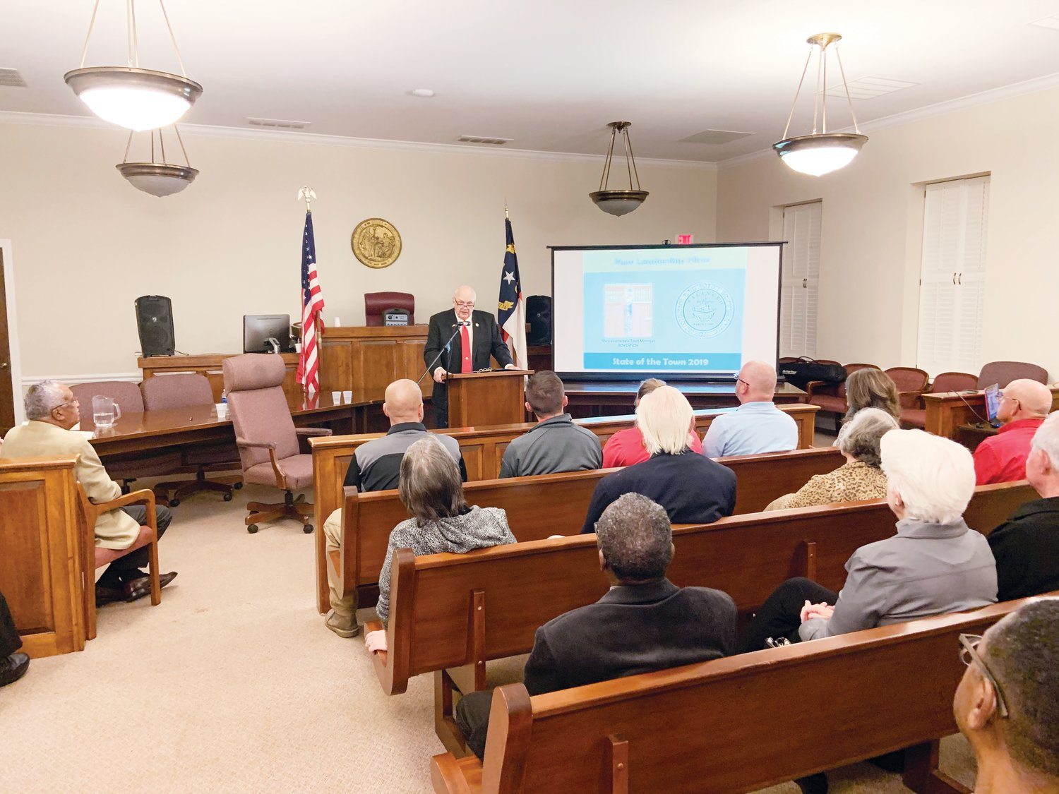 "Siler City Mayor John Grimes, front of room, talks about new town hires Monday night during the annual ""State of the Town"" address, hosted at Siler City Town Hall."