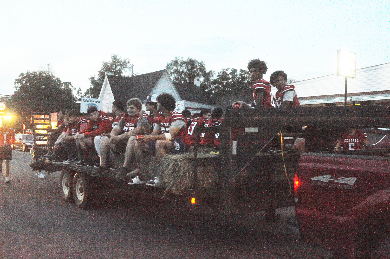 Chatham Central's football team takes a hayride along the parade route for the 2019 Homecoming Parade in Goldston last Monday night.