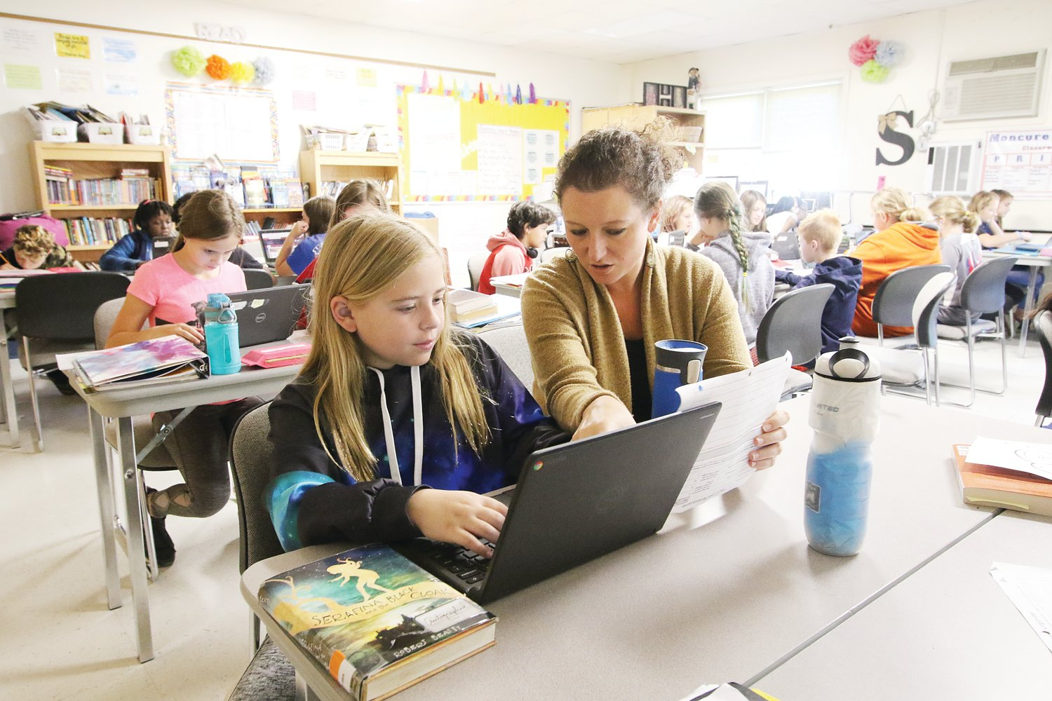 Shoup guides 5th-grader Ellie Buczynski during a vocabulary exercise.