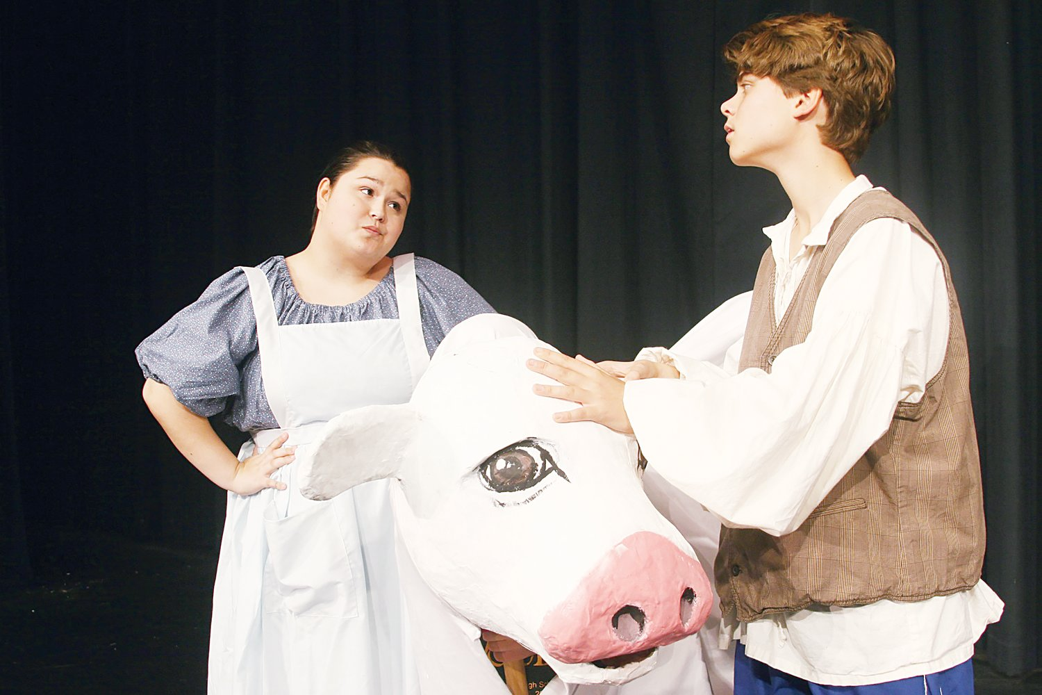Jack (Buck Thornton) pleads with his mother (Laci Burt) not to sell his beloved cow, Milky White, which is a character animated by puppeteers Calvin Conroy and Manuel Mata and designed and created by Jordan-Matthews artists.