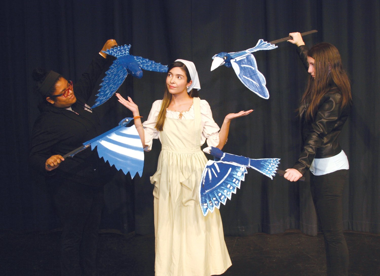 Cinderella (Kayli McIntosh, center) asks the birds to help her go to the King's Festival. Zy'kiuh Marsh, left, and Paige Colborne are puppeteers animating birds that were designed and created by JM artists.